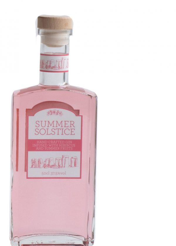 Beautiful naturally pink gin in a tall glass bottle with wooden stopper