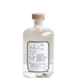 Beautiful round bottle of Test Valley Gin with a wooden stopper.