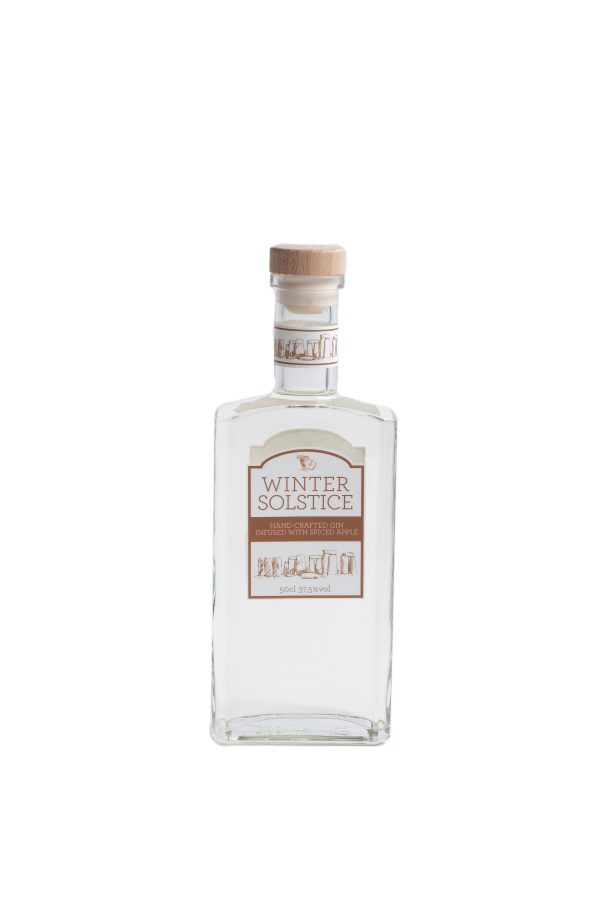 Winter Solstice gin in a tall rectangular bottle with wooden stopper