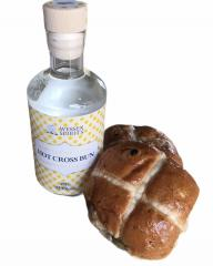Hot cross bun gin with a hot cross bun to show the bottle size